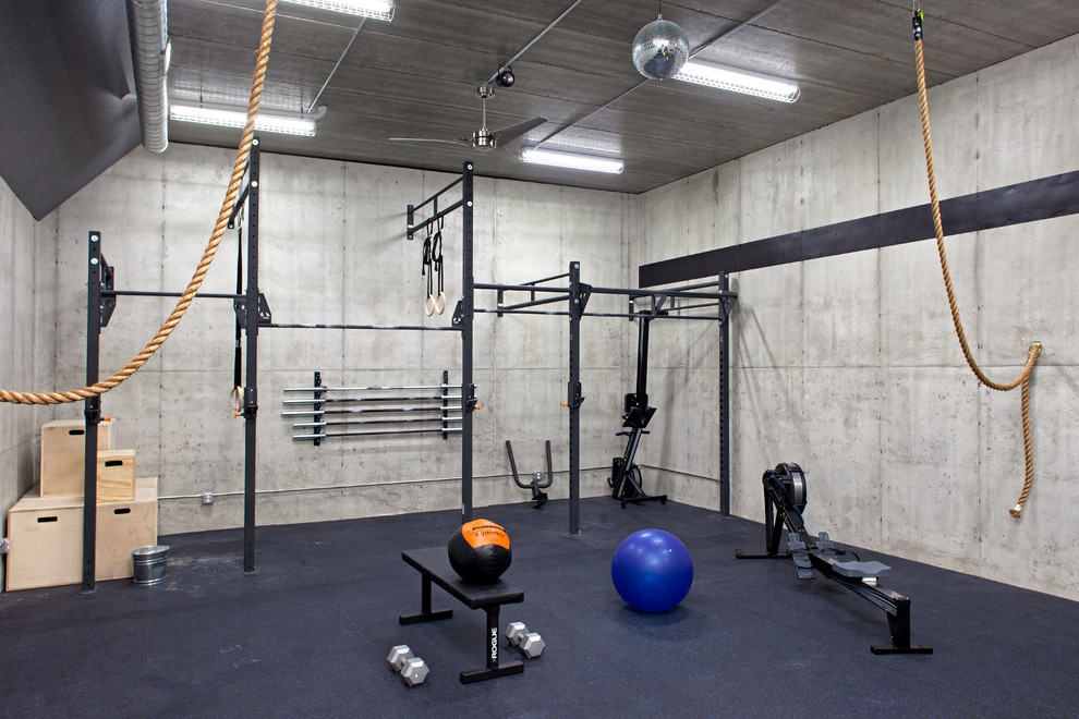 This gome gym is packed with ropes and pullup bars. An upper body workout designed training room.