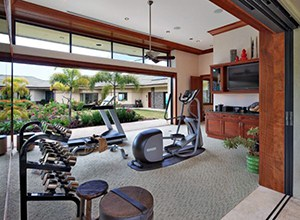 Almost Zen Like House Gym With A View Of The Garden And A Dumbbells Rack.