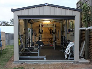 Amazing Garage Gym Idea Turns Shed Into A Home Gym With Ropes Exercise Benches Barbells Dumbbells And Power Rack
