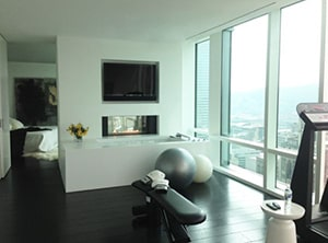 Apartment Gym In A Sky Scraper. We Think Some Hedge Fund Manager Punches Away The Stress Here And Pumps Iron On The Weight Bench.
