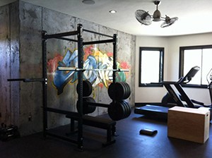 Artsy Garage Gym Idea That Came Out Perfect. Simple Design With A Power Rack With Weights And A Treadmill For Cardio.
