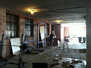 Building Outdoor Garage Gym Idea For Free Weights Strength Training. Very Open With A City Feel.