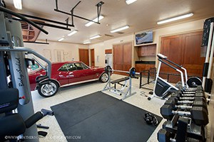 Crossfit Garag Gym Coupled With A Classy Muscle Car. Heavy Dumbbells And Heavy Motors.