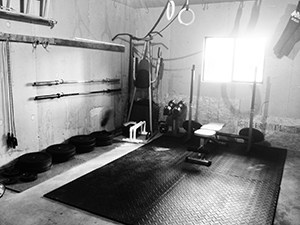 Crossfit Garage Gym Idea In Black And White. Grim Looking, But The Only Thing This Gym Is Grim To Are Calories And Fat.