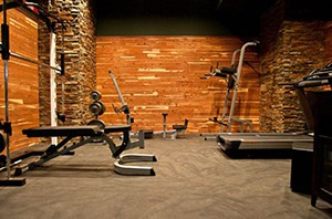 Don't Think This Is A Garage, But This Home Gym Is Unique And We Love The Wood And Stone Combo.