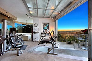 Extravagant Rich People Garage Gym Idea. Beautiful View Outside A Exercise Equipment Packed Garage.