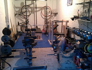 Great Home Gym Idea For Those Who Bike To Work. No Car Is Fitting In This Garage Gym, But Gains Are.