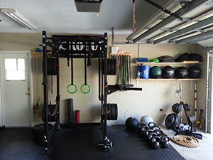 Great Utilization Of Space In This Homemade Garage Gym Complete With Rubber Bands Wall Balls And Foam Rollers