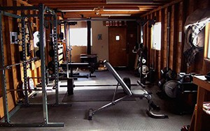 One Of The Better Garage Gym Ideas Takes A Narrow Garage And Adds Squat Racks And Weight Benches