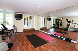 Open Gym Space In This Yoga Studio Themed Home. Light Weights And Hard Wood, Make For An Awesome Workout.