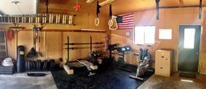 Perfect Garage Gym Example That Shows How Yard Work And A Home Gym Can Coexist. Weights And Rakes, Brother And Sister.