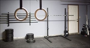 Simple Clean And Effective Gym Built In The Garage For Exercising On Ringed Ropes And Barbells With Weights