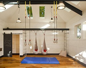 This Home Gym Has Hammocks, That's Right. Ropes And Thick Mat On Wooden Garage Gym Flooring.