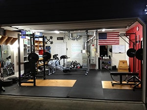Why Even Get A Gym Membership. This Garage Has It All From Bench Press Exercises To Squat Hack Machines.
