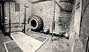 You Don't Need A Nice Home To Build A Home Gym. A Worn Out Old School Garage Will Do The Trick.