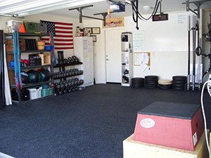 Awesome Garage Gym Photo With A Jump Box Kettle Bells And Dumbells On A Rack With Wall Balls And Barbells