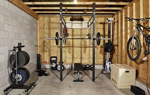 Cool Garage Gym Idea With Free Weights A Power Rack And A Bench Press