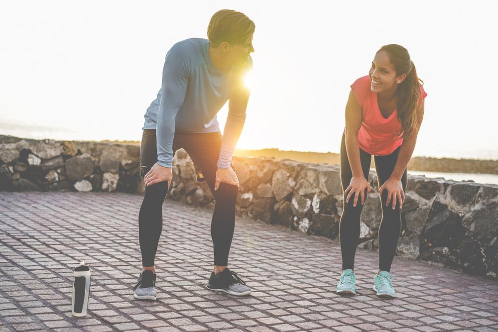 couple taking a break from a crossfit run