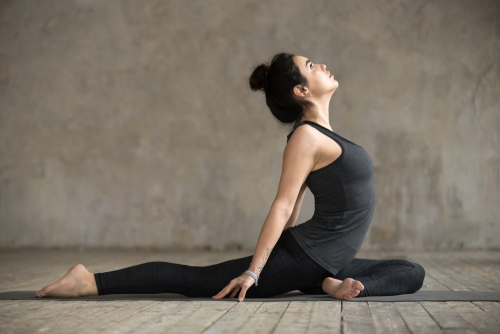 woman doing pigeon pose in yoga