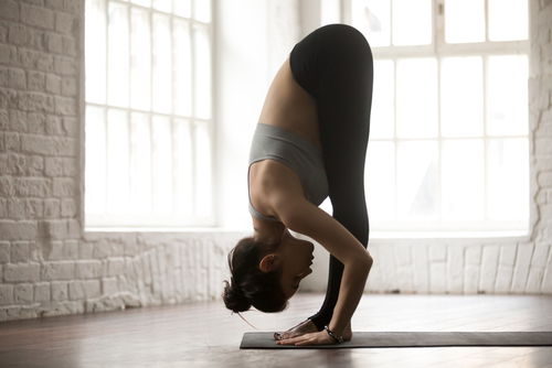 woman doing the forward fold yoga move