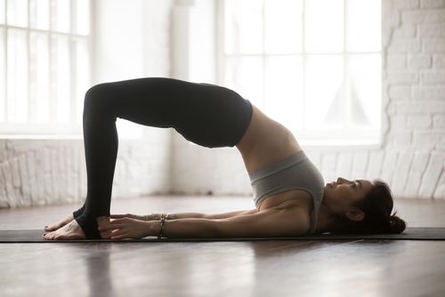 woman doing the bridge pose in yoga