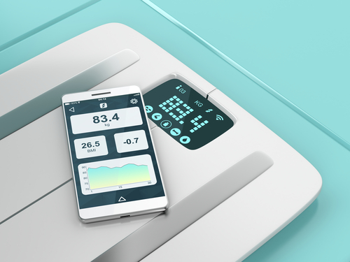 smart scale with phone sitting on top of it
