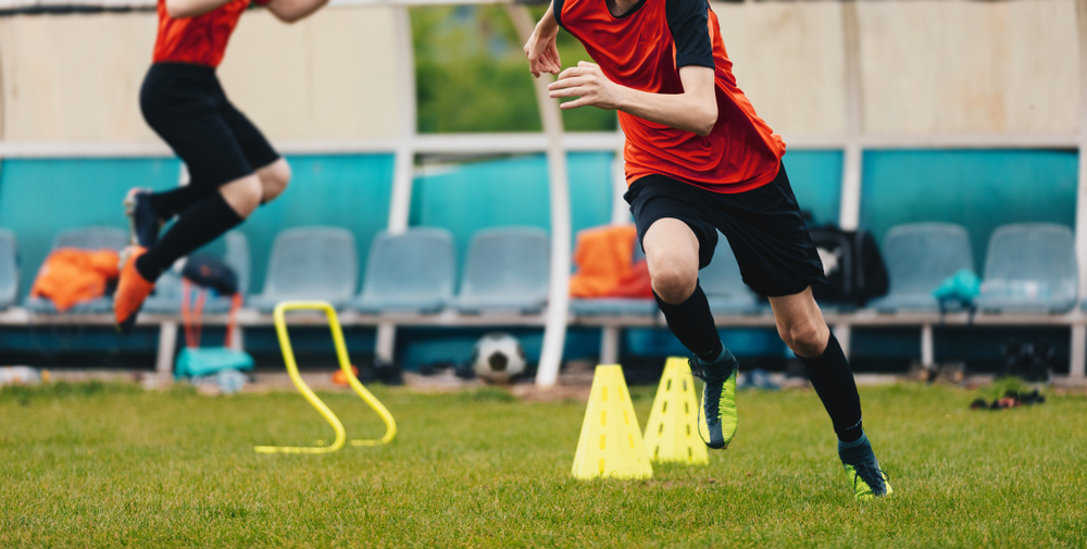 speed drill being done by a boy soccer player
